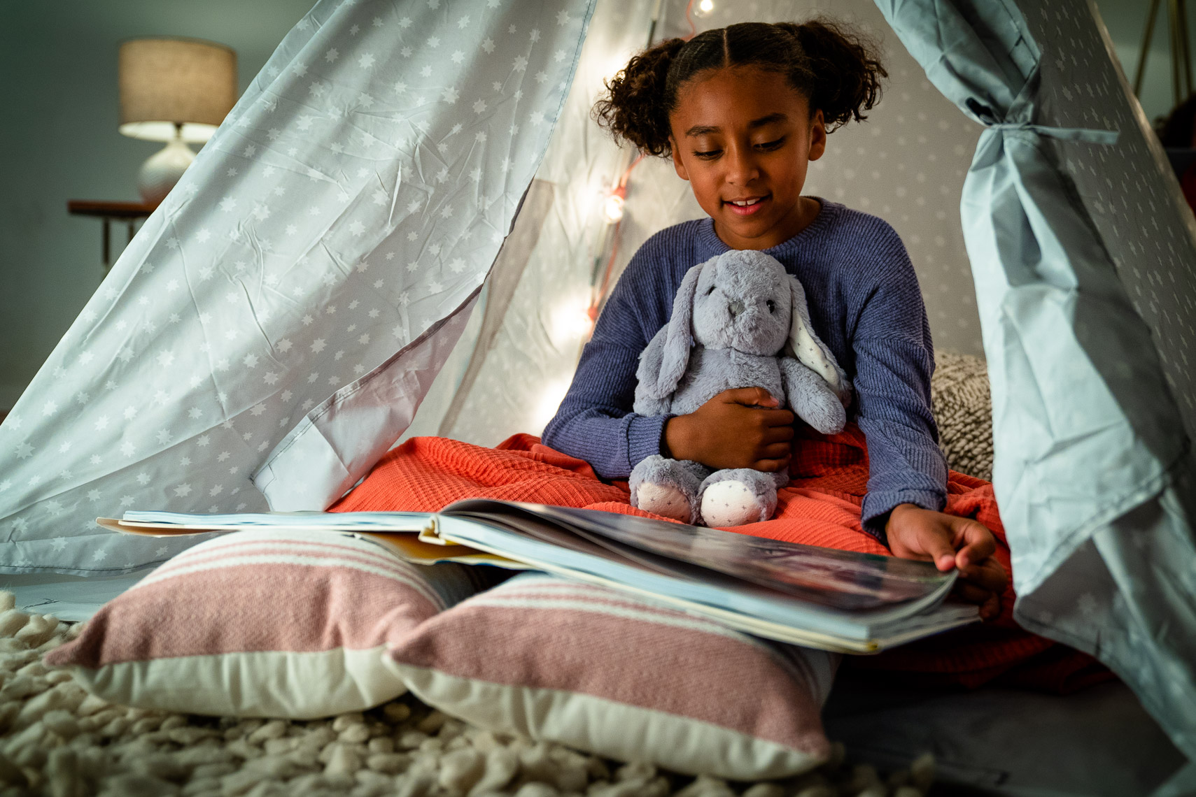Avast - Young Girl Reading Book in Living Room Tent