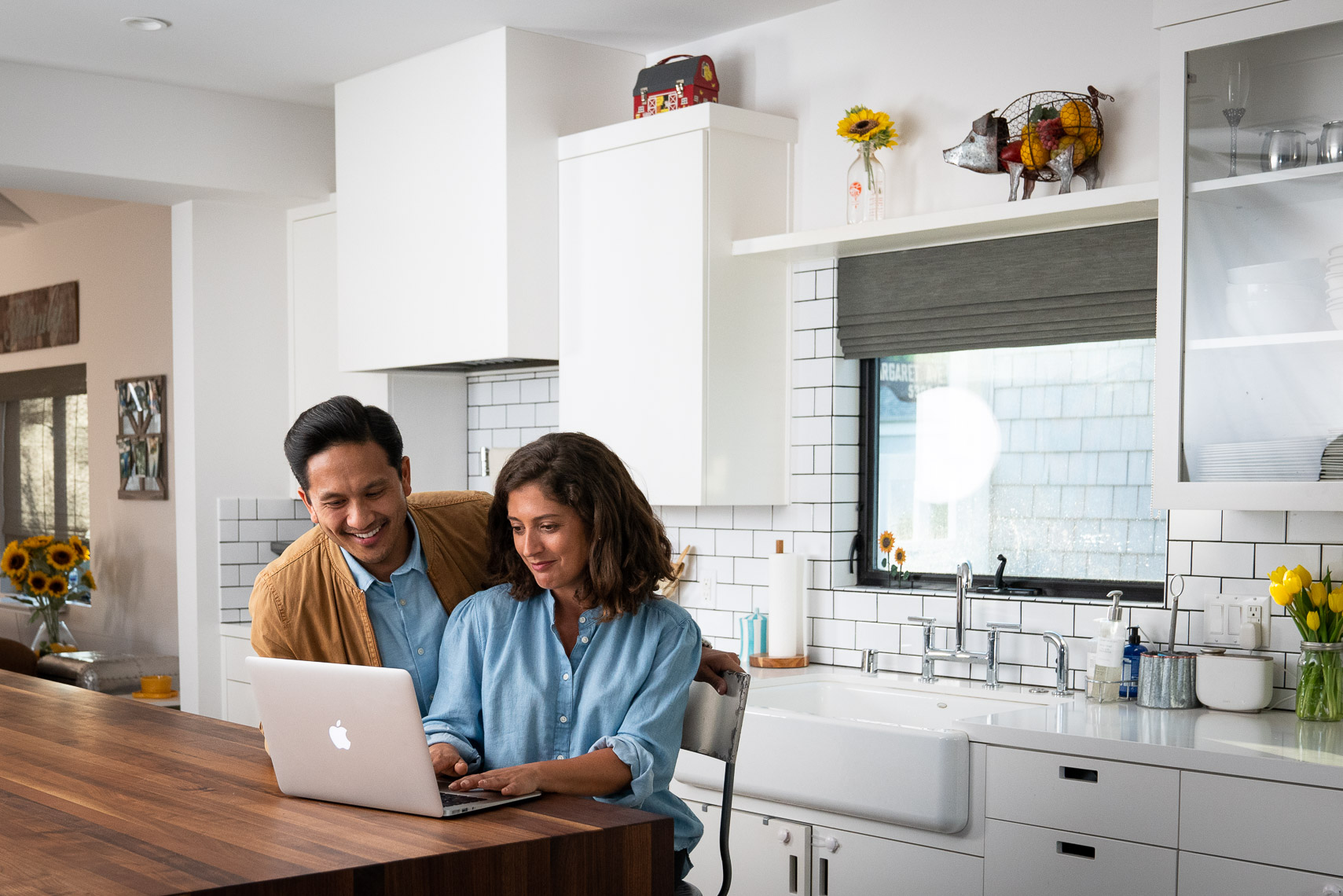 Avast - Couple Working on Laptop in Kitchen