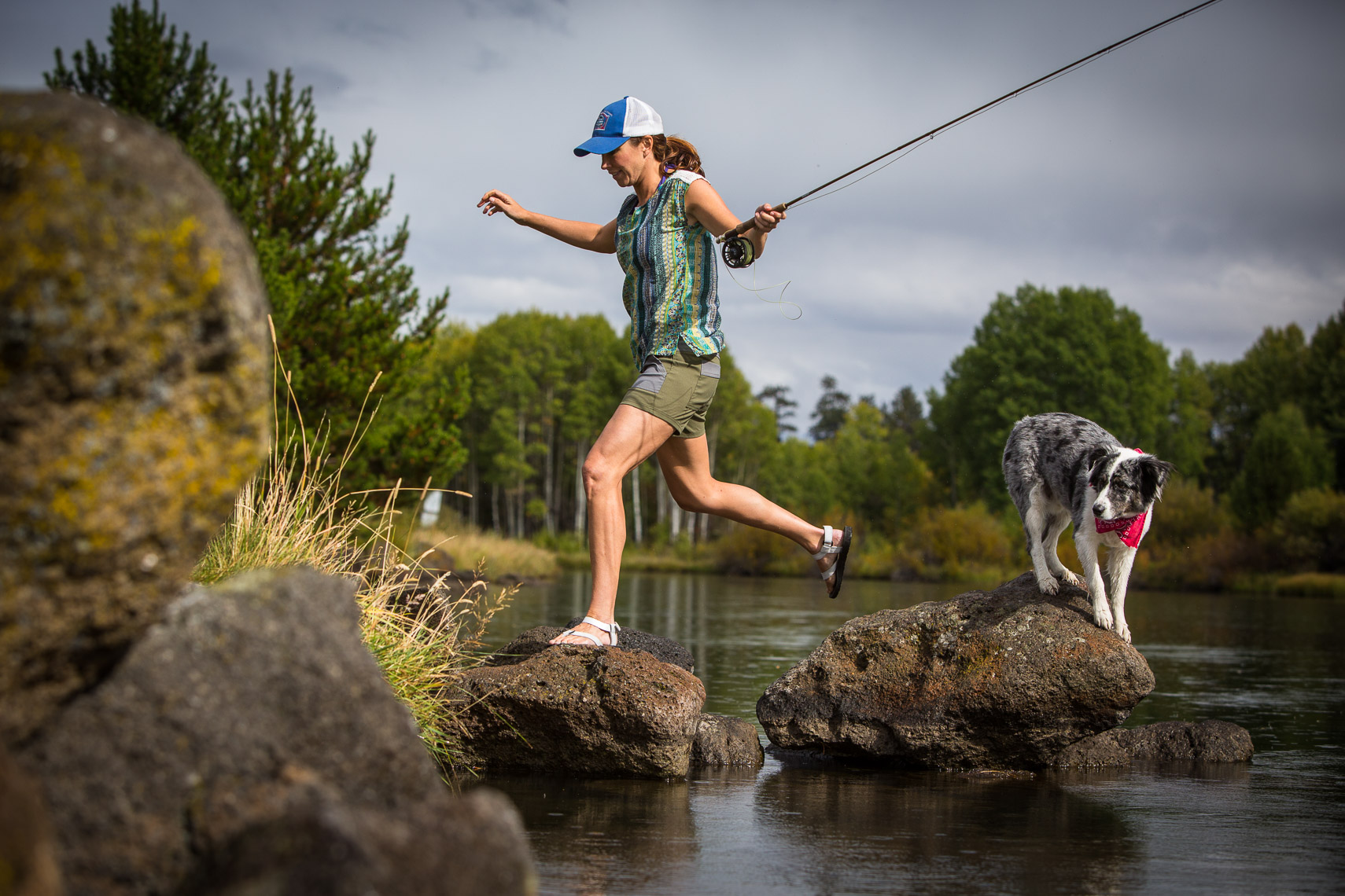 Woman Flyfishing on the Deschutes River with Dog