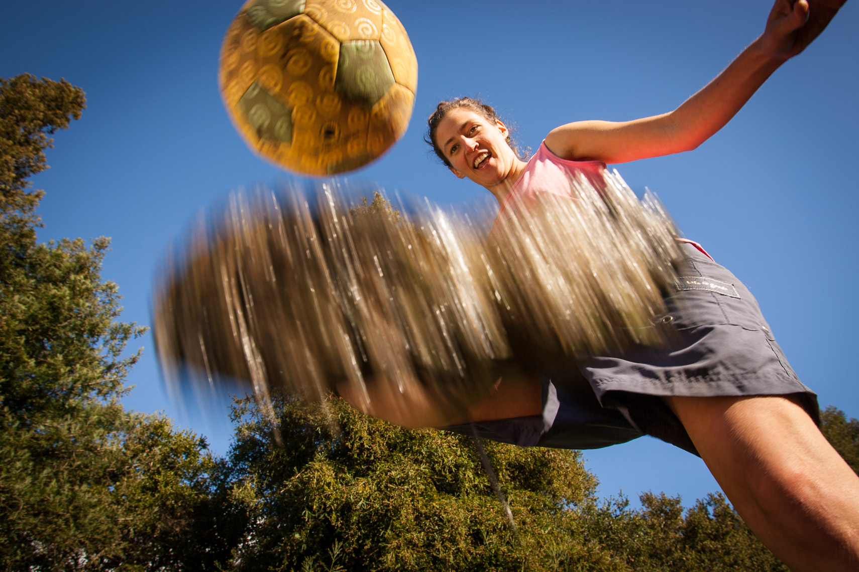 Woman Juggling a Soccer Ball