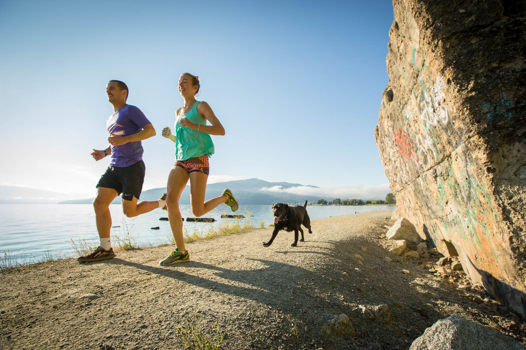 Couple Trail Running with Dog in Sand Point Idaho, Lake Pend Oreille