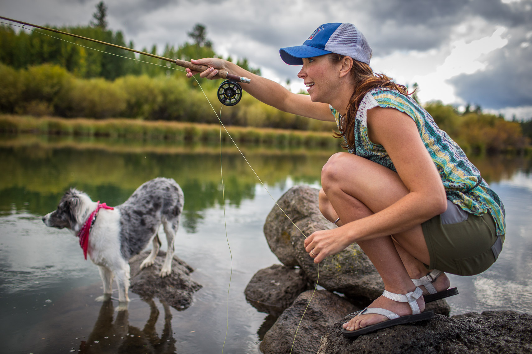 Woman and Dog Fly Fishing Deschutes River Oregon