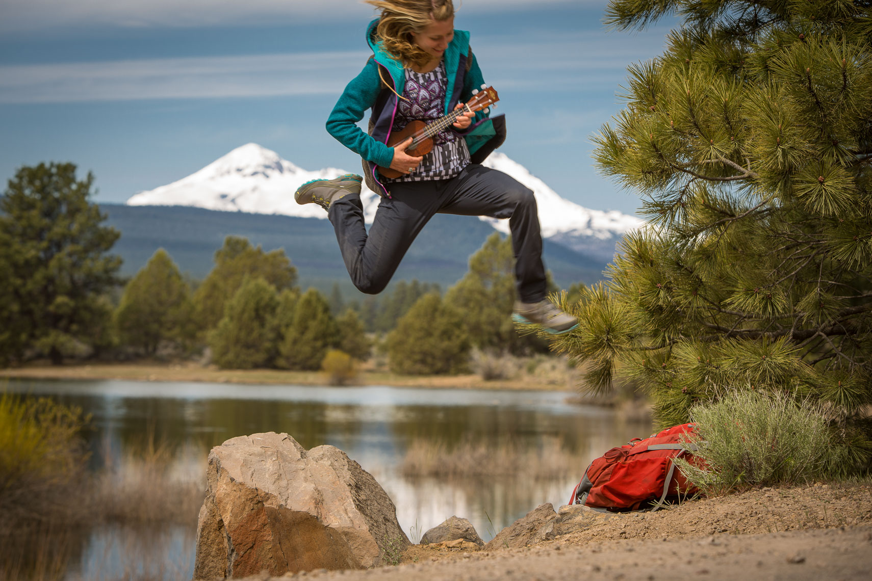 Woman Playing Ukulele in Mountains